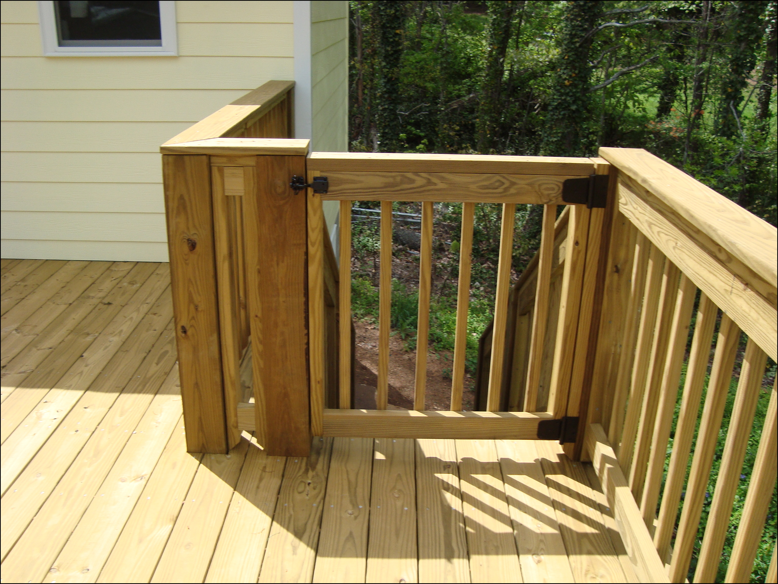 Deck stair gate final product for Porch gate plans