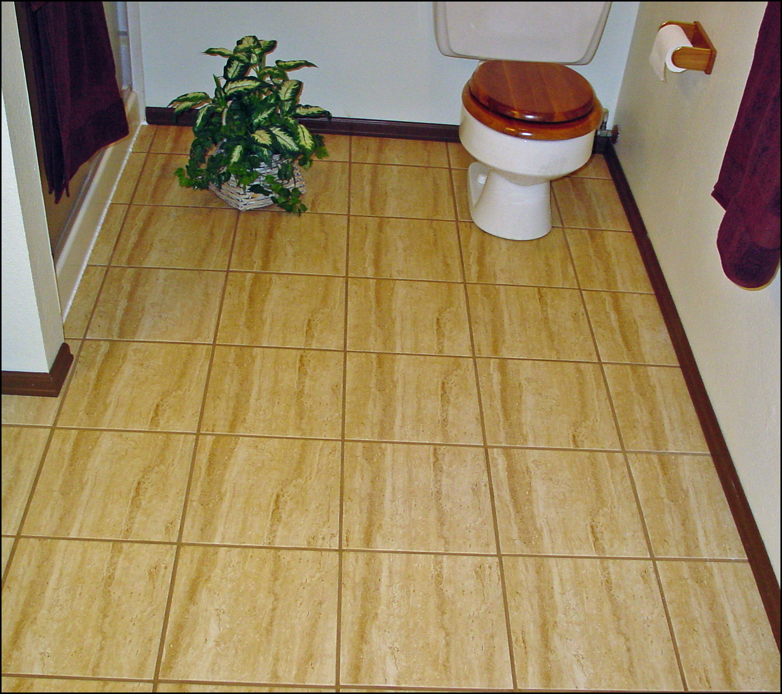 Can you put wood ground over a ceramic tile floor for Can you put vinyl flooring over tile