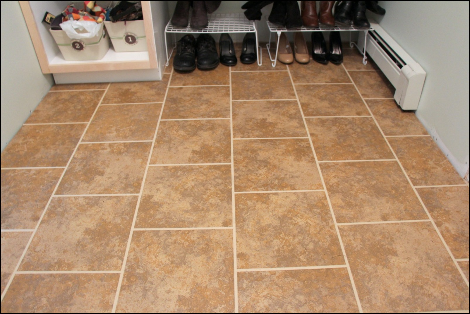Can you put wood ground over a ceramic tile floor for Can you wallpaper over tiles